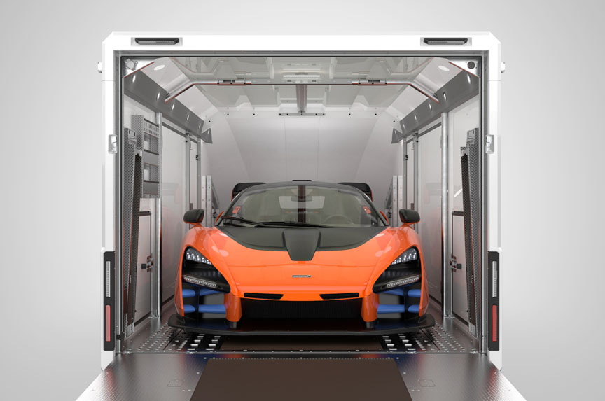 Enclosed trailer with back door open showing super car inside