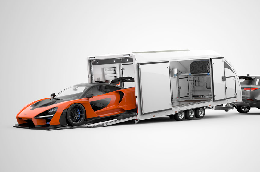 Enclosed trailer showing super car exiting via ultra low angle loading deck