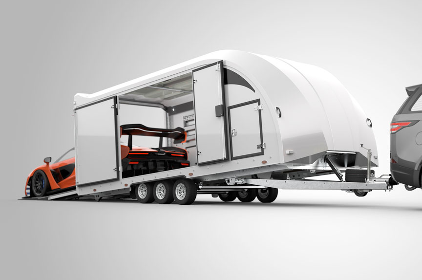Enclosed trailer showing hydraulics raising one end of the trailer for better loading angle